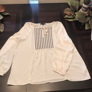 White shirt with black details